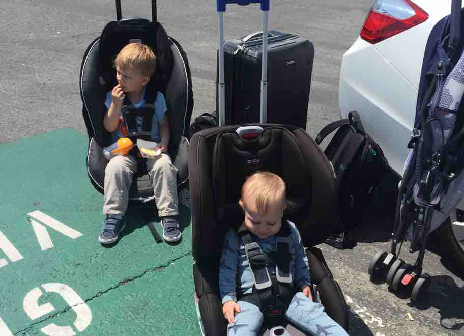 toddlers in rolling car seats